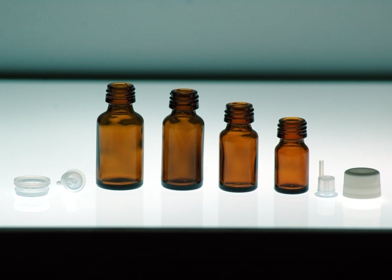 Yellow pharmaceutical glass bottle of various capacities to contain essential oils
